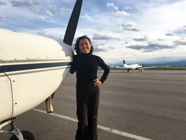 Pic of Brenda with plane 2.JPG