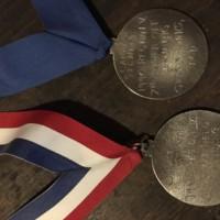 Intercollegiate Flying medals backside.jpg