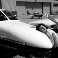 Pic. of Brenda with a plane at UD hanger 1.JPG